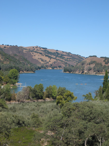 A picture of the lake from the top of the road
